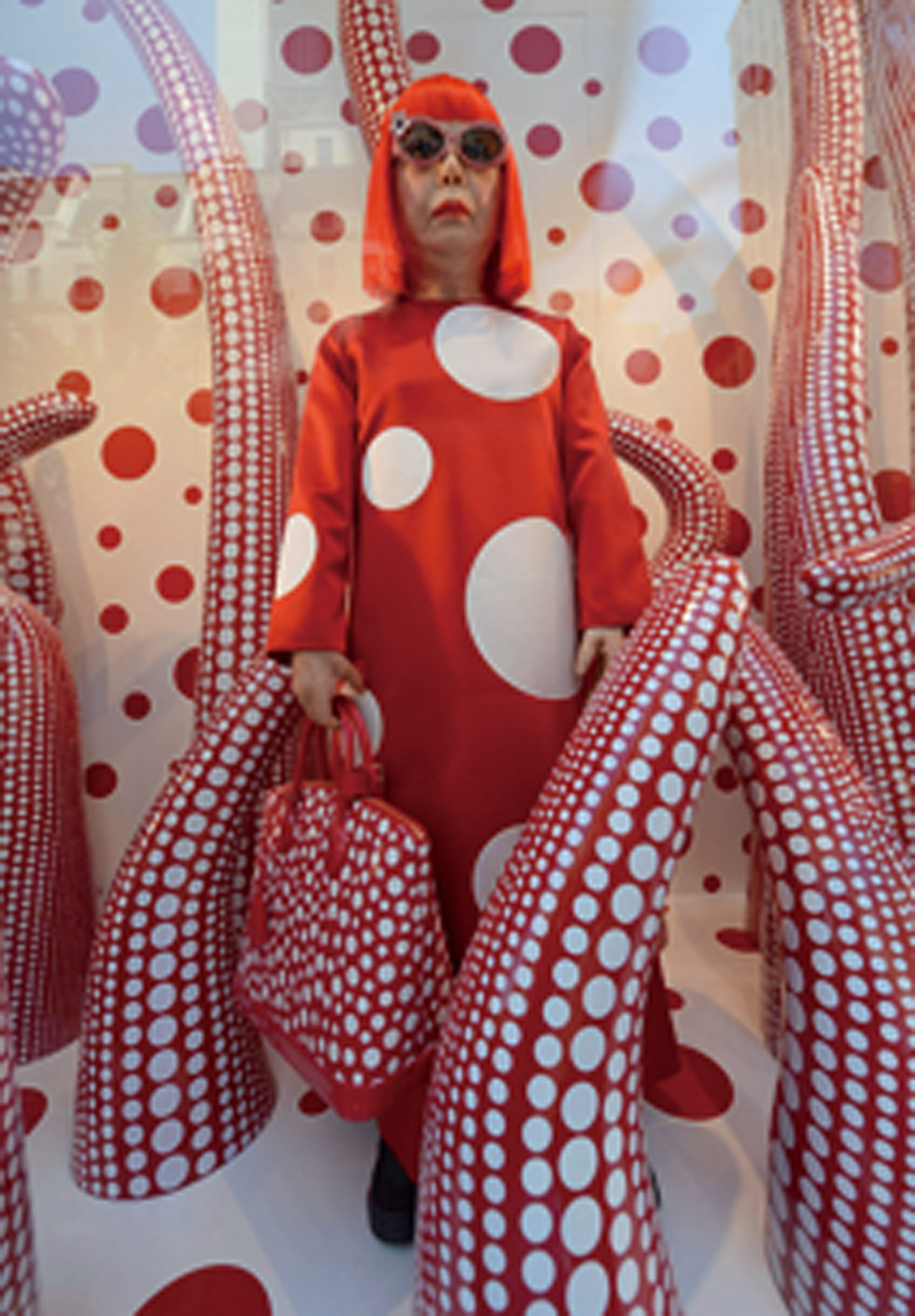 NEW YORK, NY - JULY 10: A wax figure of artist Yayoi Kusama on display during the Louis Vuitton And Yayoi Kusama Collaboration Unveiling at Louis Vuitton Maison on July 10, 2012 in New York City. (Photo by Dimitrios Kambouris/WireImage)